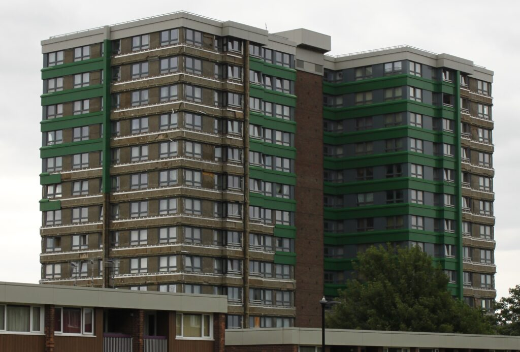 A residential tower block in Sheffield has some of its exterior panels removed with the cladding exposed for inspection following the Grenfall Tower fire, July 2017.